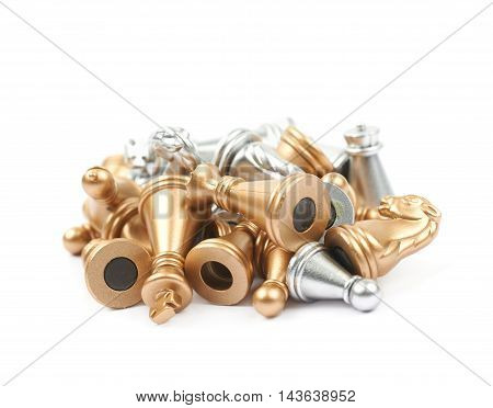 Pile of golden and silver chess figures isolated over the white background