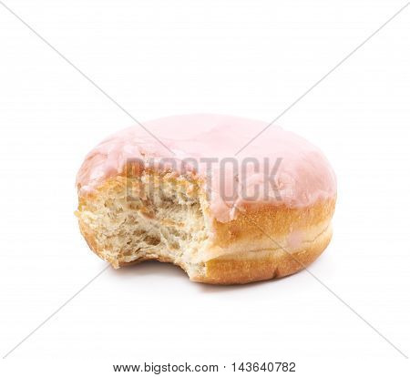 Pink glazed donut with a bite taken of it, composition isolated over the white background