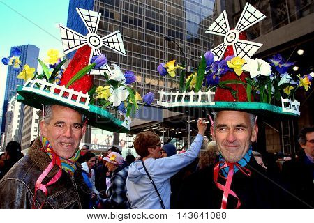 New York City - April 11 2009: Two men wearing imaginative Dutch windmill bonnets at the Easter Parade on Fifth Avenue