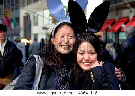 New York City - March 24 2007: Two Asian women wearing bunny ears are all smiles at the Fifth Avenue Easter Parade