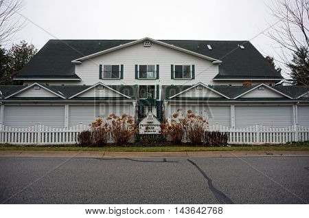 WEQUETONSING, MICHIGAN / UNITED STATES - DECEMBER 22, 2015: The Pennsylvania House is a condominium on Pennsylvania Avenue in Wequetonsing.