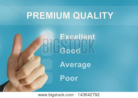 business hand clicking premium quality button on screen