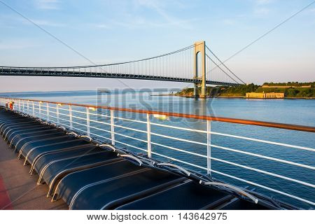 A view of the Verrazano Narrows Bridge from the deck of a cruise ship as it passes by.