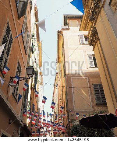 French Alley With Colorful Bunting And Sunshine