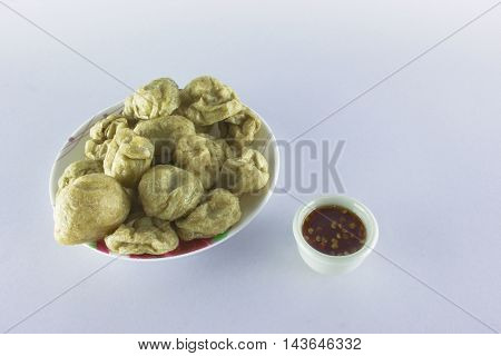 fry meatballs on white background with selective and soft focus