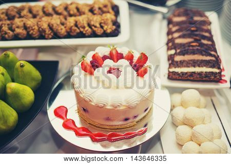 Delicious and tasty dessert table at wedding reception