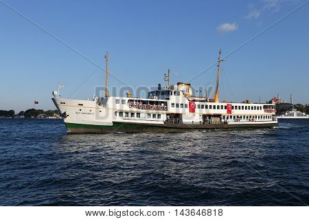 ISTANBUL TURKEY - JULY 25 2016: Sehir Hatlari ferry carry passengers between Asian side to European side of Istanbul. Sehir Hatlari was established in 1844 and now carry 150000 passengers a day.