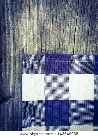 Fabric in bavarian colors on wooden background