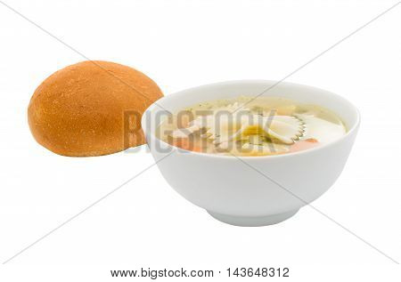 Chicken soup with a bun on a white background