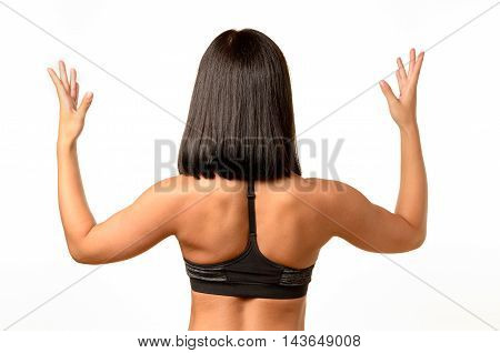 Rear View Of A Tanned Woman With Raised Arms