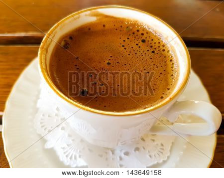 A cup of hot beverage; delicious Turkish coffee.