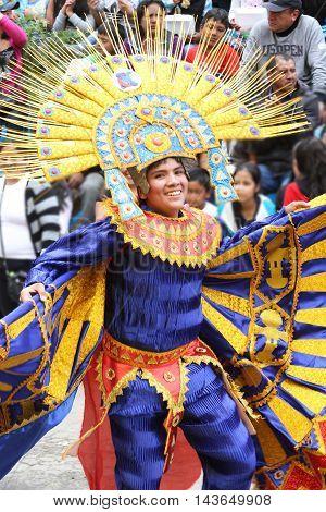 Cajamarca Peru - February 8 2016: Peruvian man with Sun God costume dances in Carnival parade in Cajamarca Peru on February 8 2016