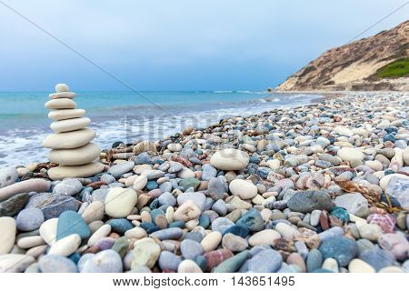 Pyramid of zen stones on Cyprus beach