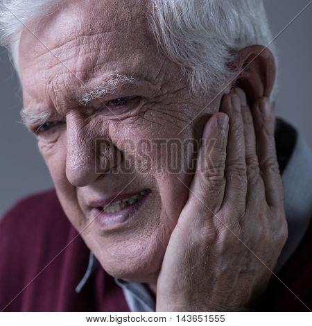 Senior Man Having Toothache