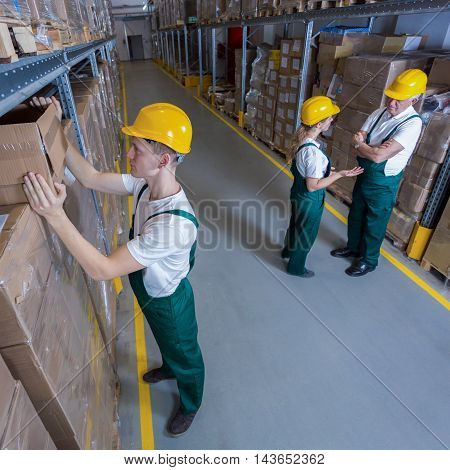 Plant workers during their work in warehouse
