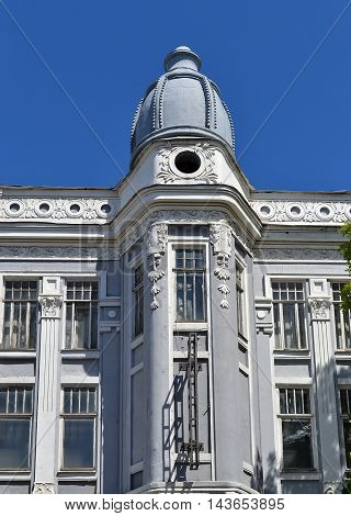 Beautiful building with stucco mouldings and dome, in Ulyanovsk, Russia. The fragment on the background of blue sky.