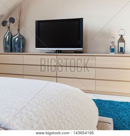 New television set in modern small bedroom