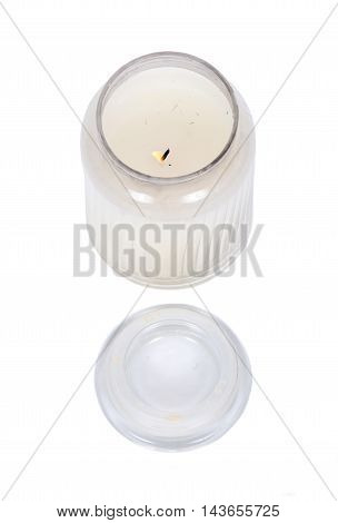 White candle in house warmer house jar separated on white background