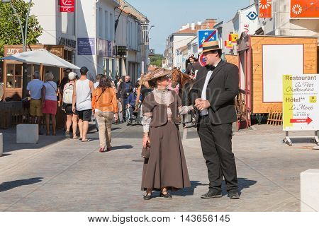 Couple Dressed With Period Clothes Walks Through The Street