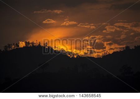 a picture of sunset. a colorful sunset. color the whole sky in various shades.