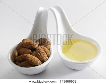 almond and spoon of oil