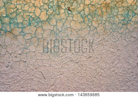 Old Cracked Wall Background In Green And Gold Colors In The Top And Grey At The Bottom