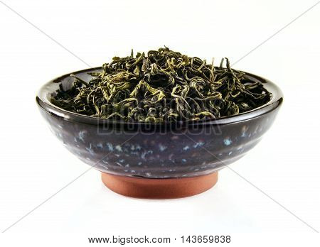 Chinese green tea in tea cup on white background