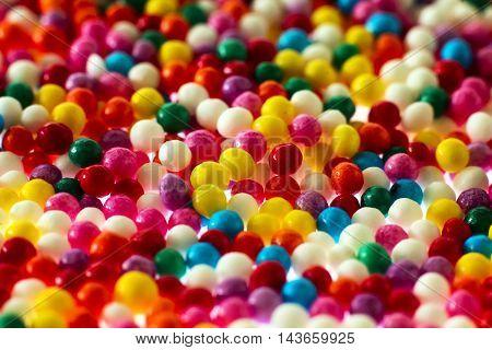 Many sprinkles close up on white background