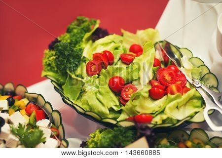 Colorful salads on the buffet and wedding table