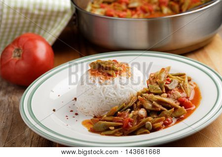 Green bean stew with rice on a plate
