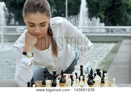 Woman Lost In Thought Over The Course Of A Game Of Chess