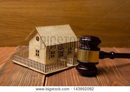 Auction. Law. Miniature House on wooden table and Court Gavel.