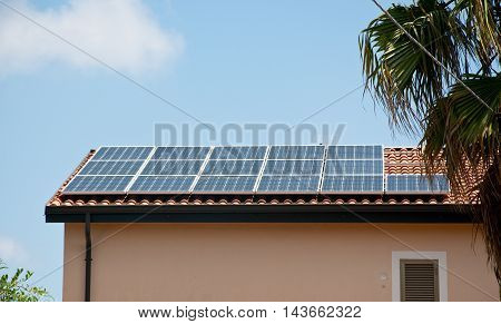 roof- installed solar panels that are used to make electricity