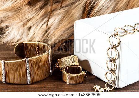 beautiful jewelry made of gold and precious stones bracelets earrings