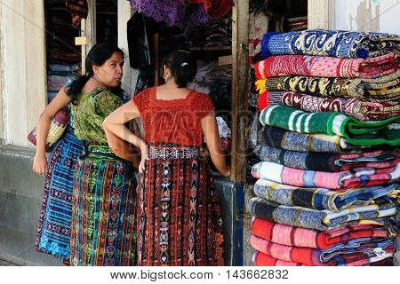 SAN PEDRO LA LAGUNA GUATEMALA - JANUARY 20: Ethnic women from Guatemala are doing the shopping of colour materials in order to make new dresses for oneself in the city San Pedro La Laguna in Central America in January 20 2013