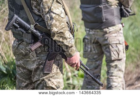 Chonhar, Ukraine - Marth 18: Ukrainian soldier holds modified AK-74 rifle on the government controlled territory of Ukraine border with the occupied by Russia territory of Crimean Peninsula.