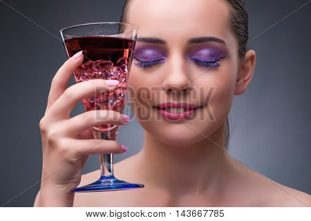 Nice woman drinking red cocktail