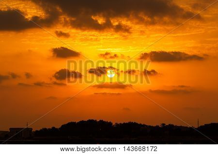 Bahrain Skyline during a beautiful sunrise with clouds.
