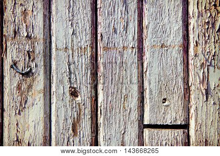 old painted wooden planks with cracked paint