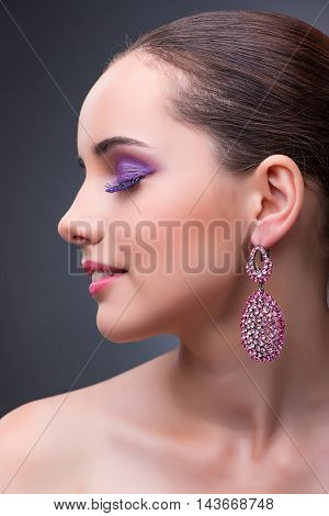 Beautiful woman with jewellery in fashion concept
