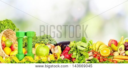 Vegetables and fruits over abstract background.