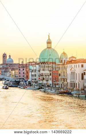 Venice cityscape view on the Grand canal with dome of San Piccolo Simeone church at the sunrise