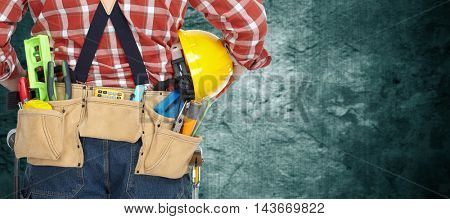 Builder with construction tools.