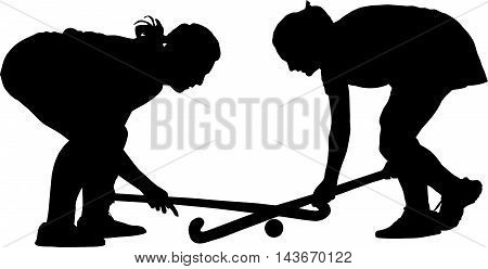 Silhouette Of Girl Ladies Hockey Players Locked In Battle For Ball