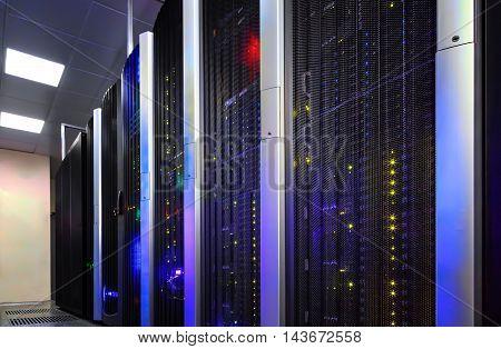 Data center full of the server cabinets and racks