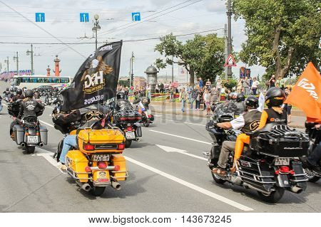 St. Petersburg, Russia - 12 August, Riding on motorcycles people with flags, 12 August, 2016. The annual parade of Harley Davidson in the squares and streets of St. Petersburg.