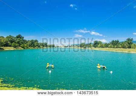 Rowing path on beautiful Jarun lake in Zagreb, Croatia, sunny summer day