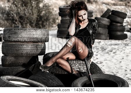 Disheveled Redhead Woman With A Baseball Bat