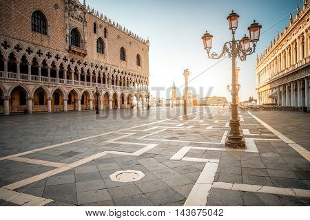 Morning view on San Marco square with Doges palace and San Giorgio Maggiore island on the background