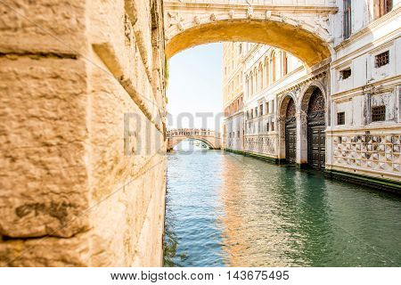 Water canal with famous bridge of Sights near Doges palace in Venice